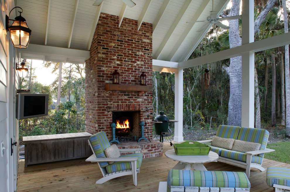 This is an example of a traditional porch design in Jacksonville with a fire pit and decking.