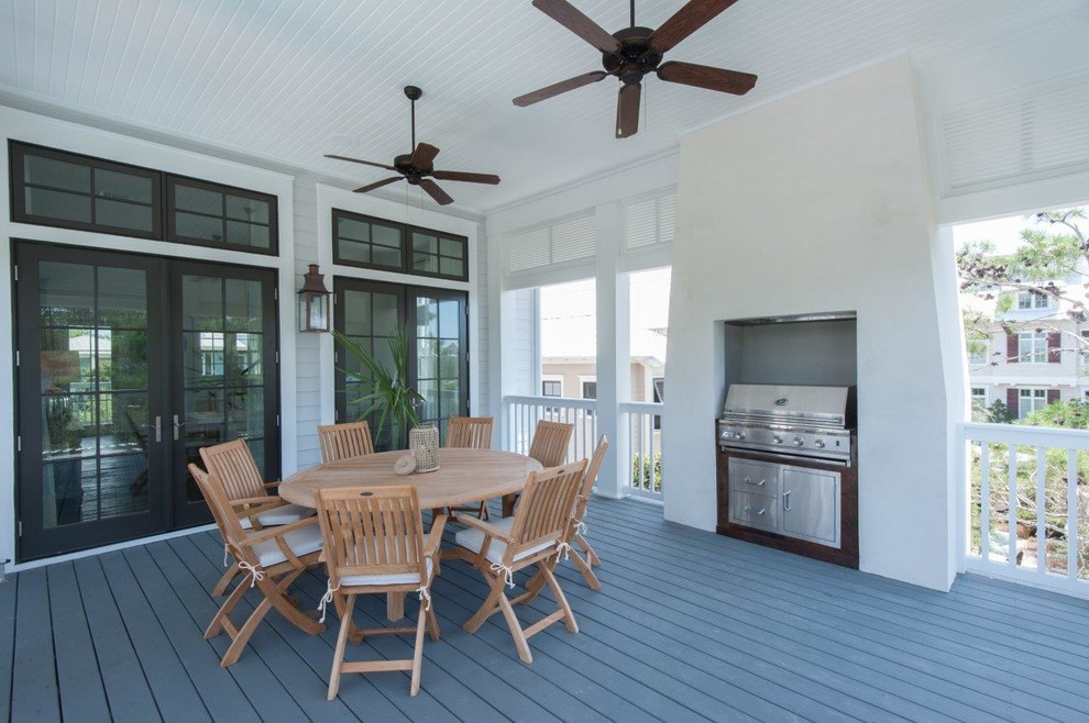 This is an example of a coastal porch design in Tampa.