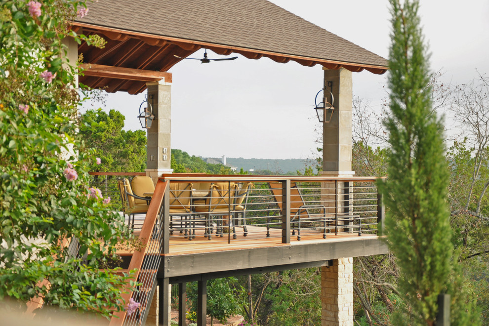 Large classic back porch idea in Austin with decking and a roof extension