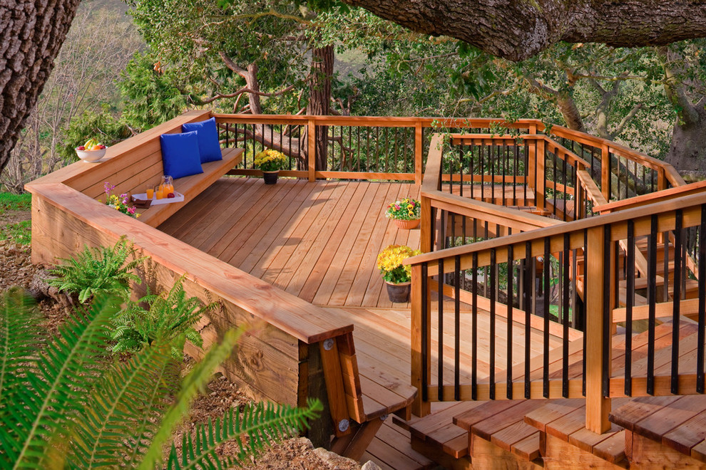Inspiration for a large contemporary back porch remodel in San Francisco with decking