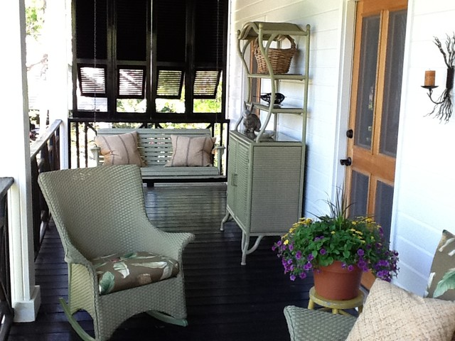 Antique shutters on porch traditional-porch