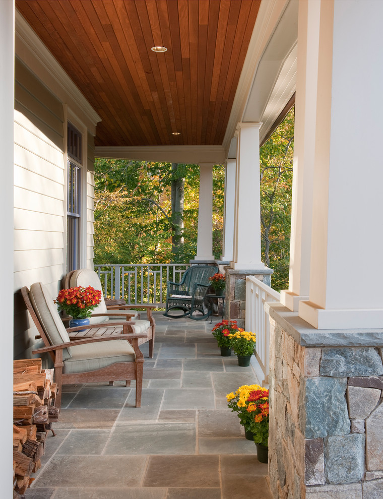 Inspiration for a mid-sized craftsman front porch remodel in DC Metro with a roof extension