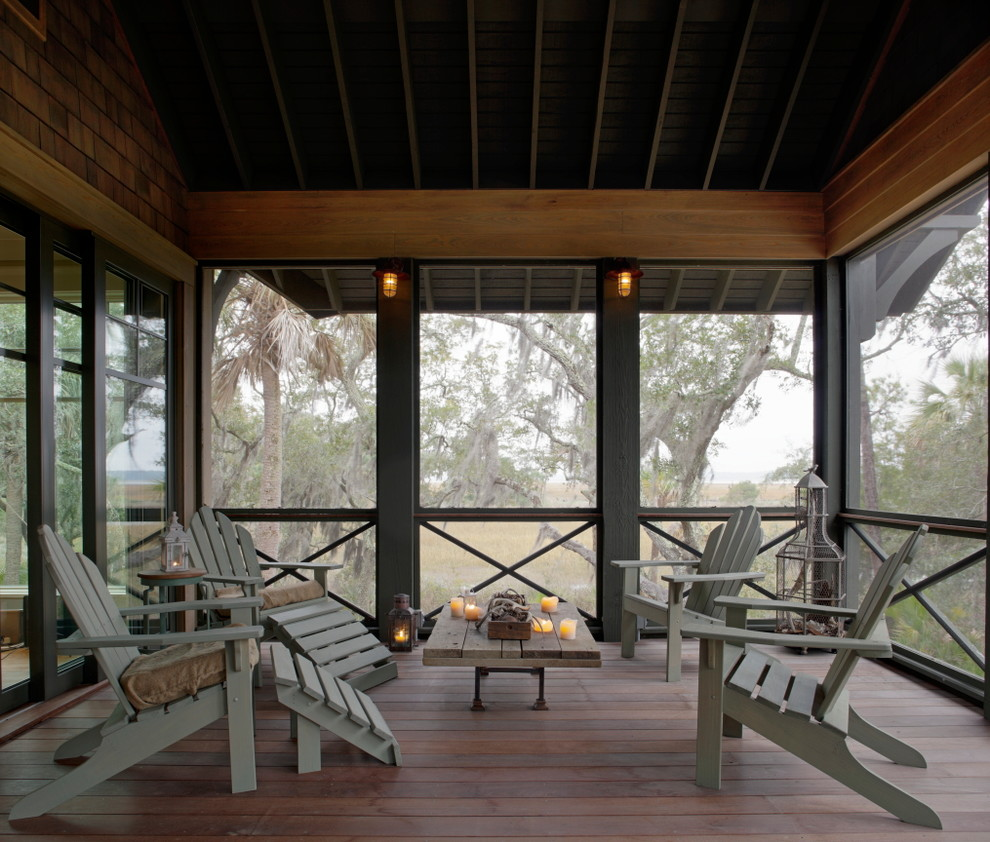 Inspiration for a rustic screened-in porch remodel in Atlanta