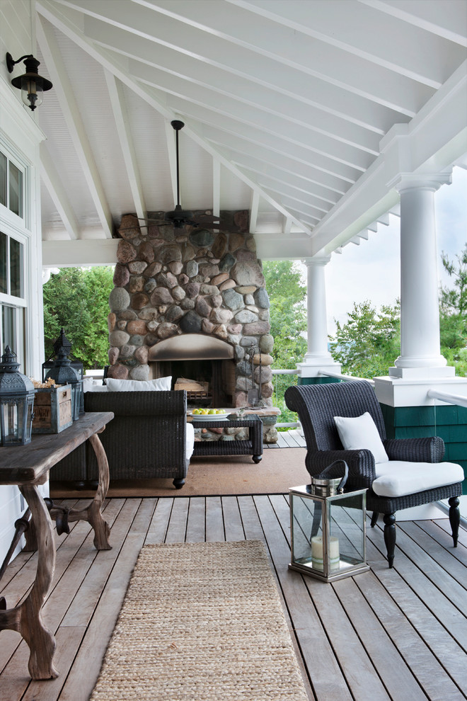 Beach style front porch idea in Other with a fire pit, decking and a roof extension