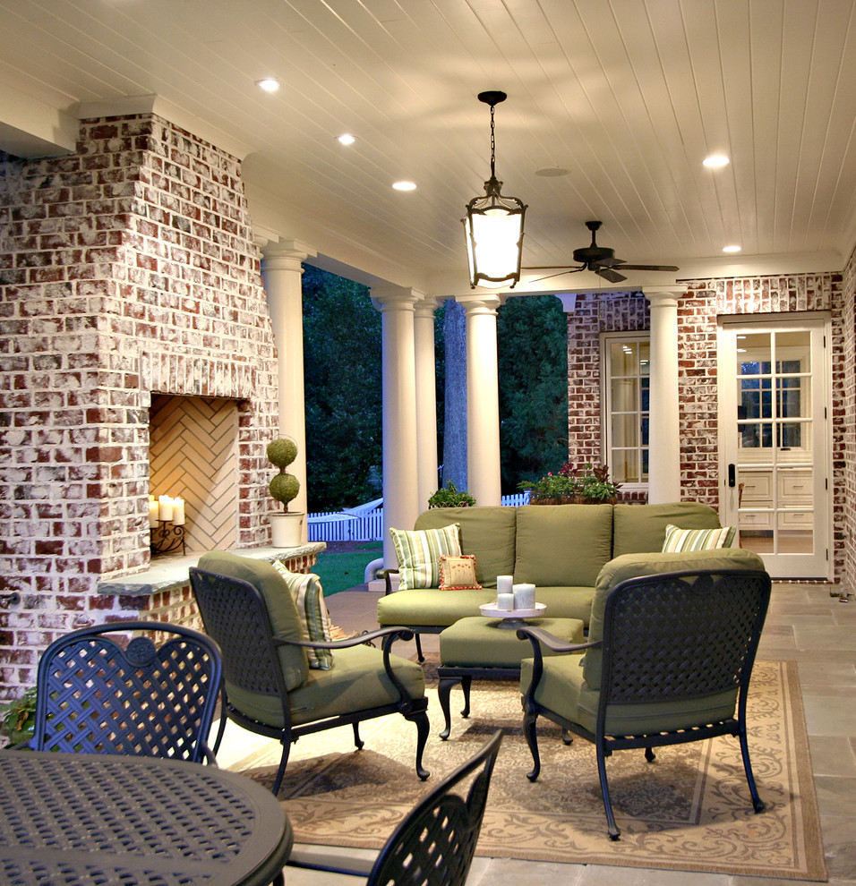 Classic porch idea in Atlanta with a fire pit