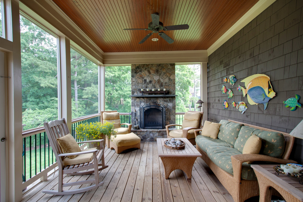 Elegant porch photo in Raleigh with a fire pit and decking