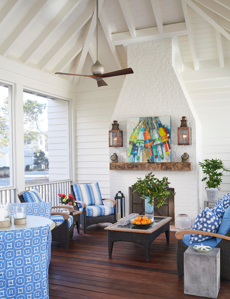 This is an example of a coastal porch design in Atlanta.