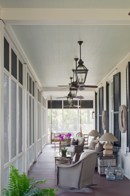 Inspiration for a beach style screened-in porch remodel in Charleston