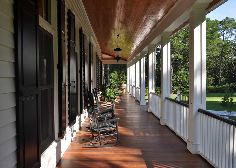 Large classic porch idea in Atlanta with decking and a roof extension