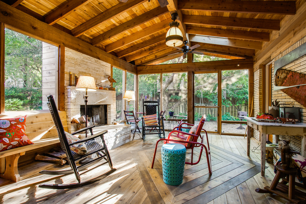 Inspiration for a large rustic screened-in porch remodel in Dallas with decking and a roof extension