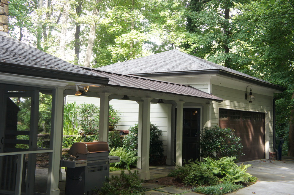 This is an example of a traditional porch design in Atlanta.