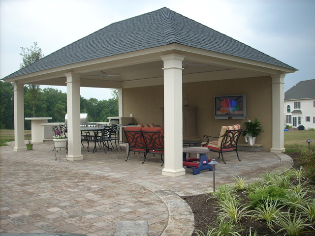 Cabana With Outdoor Fireplace And Kitchen Area