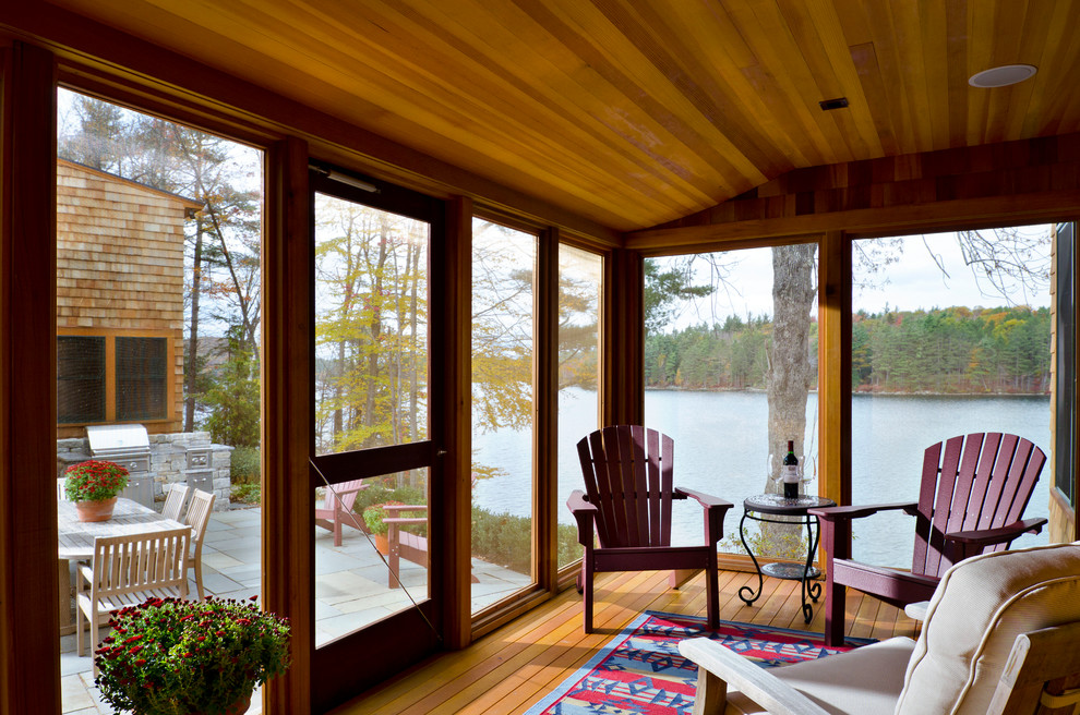 Mountain style porch photo in Boston with decking and a roof extension