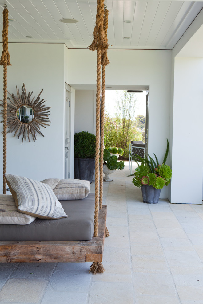 Coastal porch container garden photo in Orange County with a roof extension