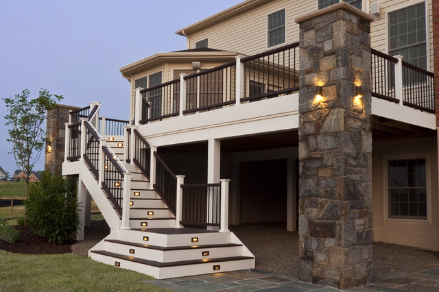 Composite deck and staircase with stone pillar traditional porch