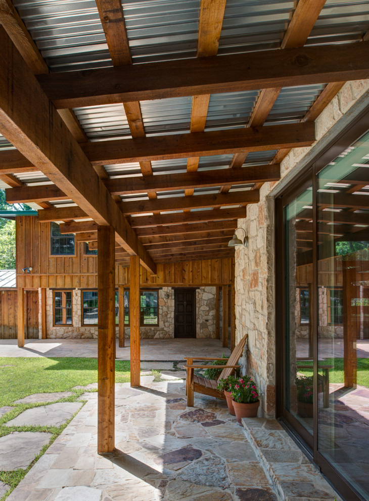 Inspiration for a contemporary porch remodel in Austin with a roof extension