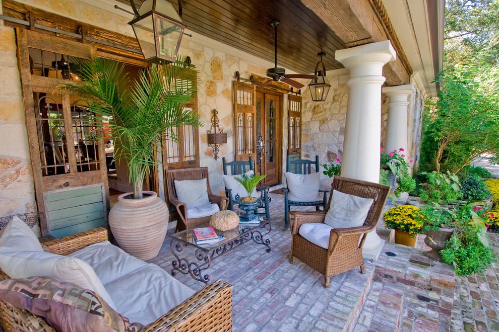 Elegant brick porch photo in Little Rock