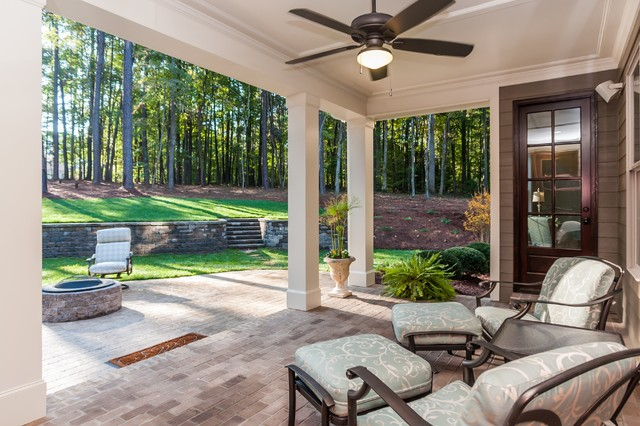 covered back porch from the gates at ethans glen gold parade home by robuck des traditional - Back Porch Patio Ideas