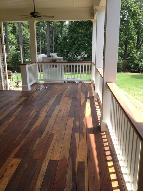 Covered ipe wood deck traditional porch atlanta by for Covered porch flooring options