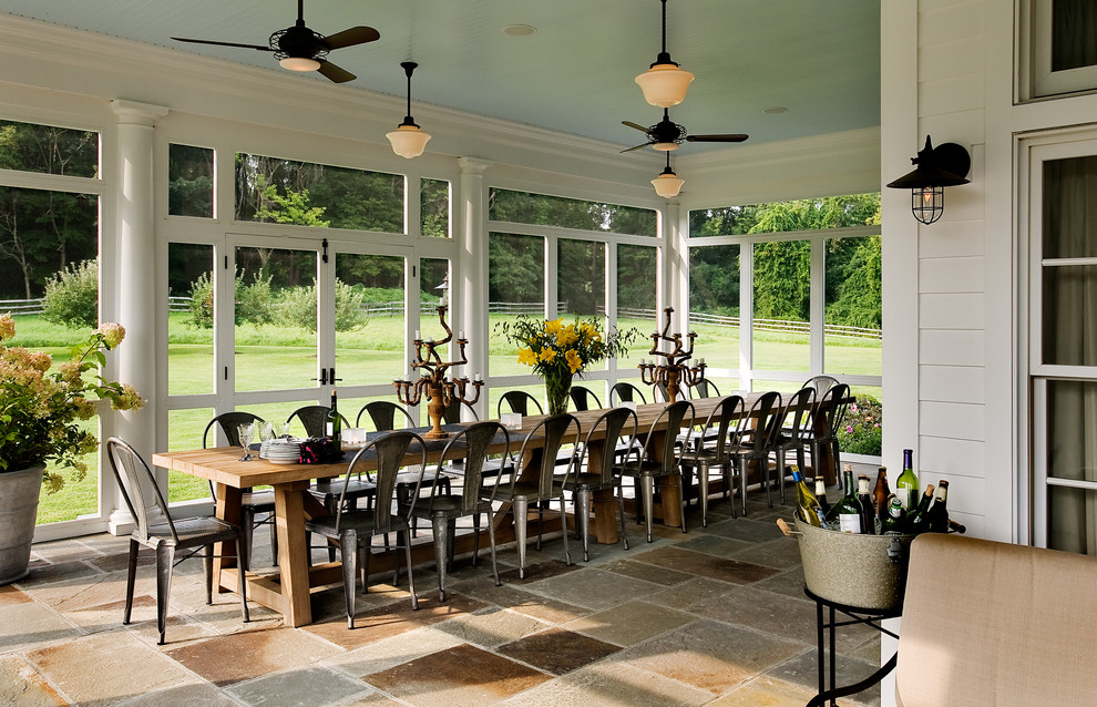 Country screened-in porch photo in New York with a roof extension