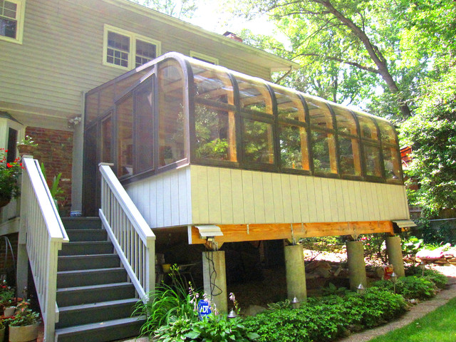 Curved Eave Sunroom On A Raised Deck Traditional Porch