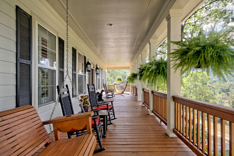 Large elegant front porch photo in Atlanta with decking and a roof extension
