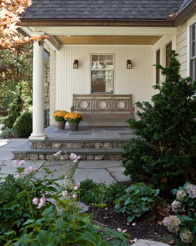 Elegant porch photo in Boston with a roof extension