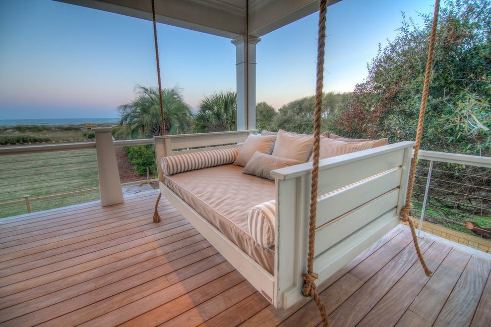 This is an example of a tropical porch design in Charleston.