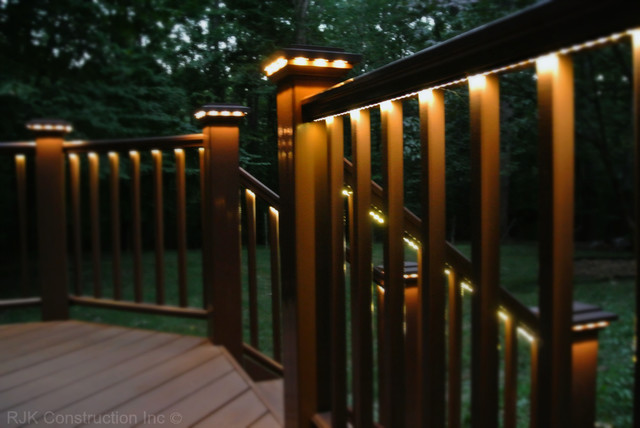 Deck with rail lighting traditional porch dc metro Patio and deck lighting ideas
