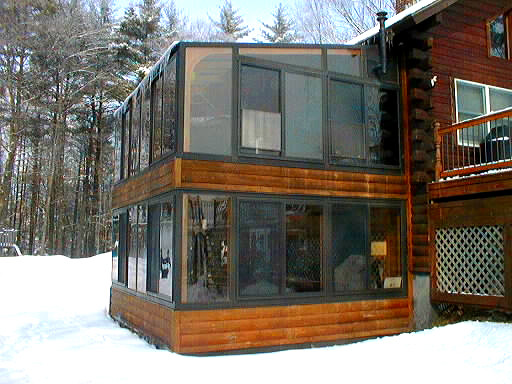 Double decker sunroom on a log home rustic porch for Log home sunrooms