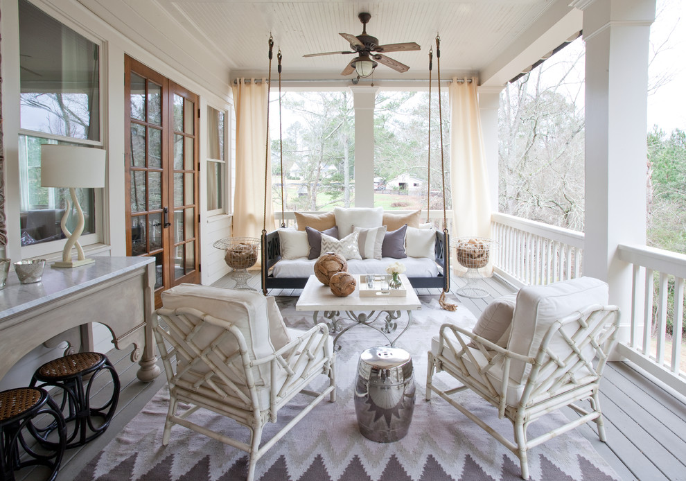 Inspiration for a large timeless back porch remodel in Atlanta with decking and a roof extension