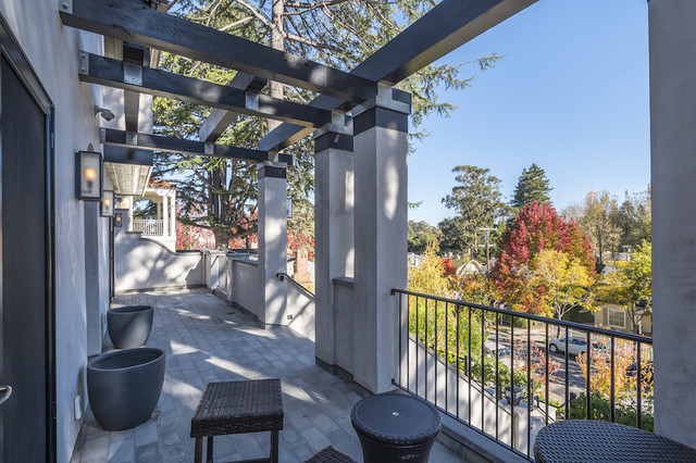 Large trendy tile front porch idea in San Francisco with a pergola