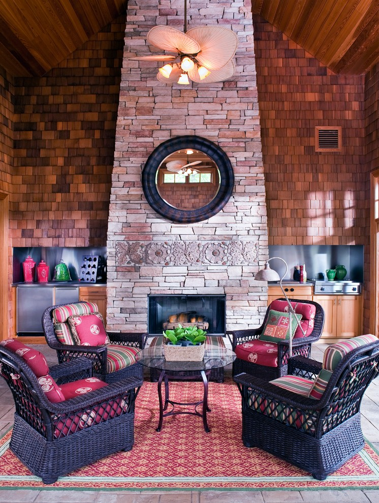 Classic porch idea in Minneapolis with a fire pit