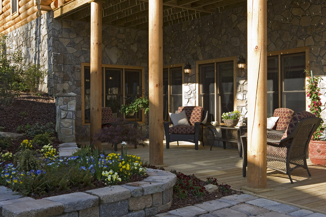 Exterior of a rustic round log and timber home traditional-porch