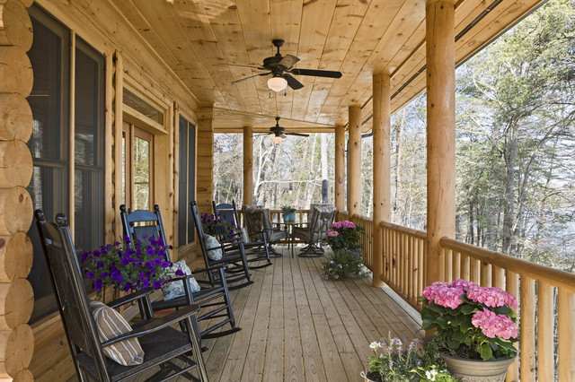 Exterior Of A Rustic Round Log And Timber Home - Traditional