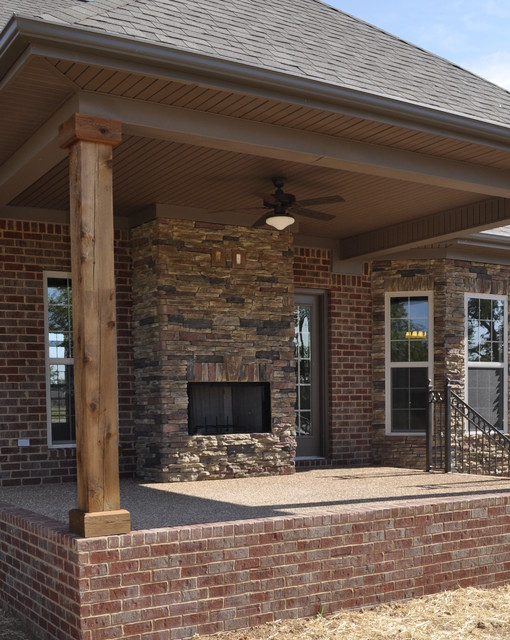 Wood Columns For Homes : Exterior stone fireplace and cedar posts contemporary