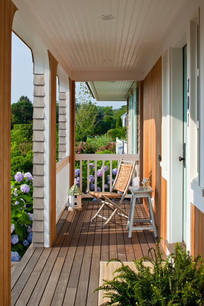 This is an example of a traditional porch design in Boston with decking.