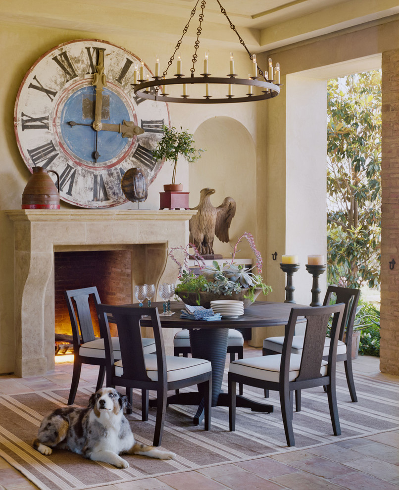 Inspiration for a mediterranean porch remodel in Los Angeles with a fire pit