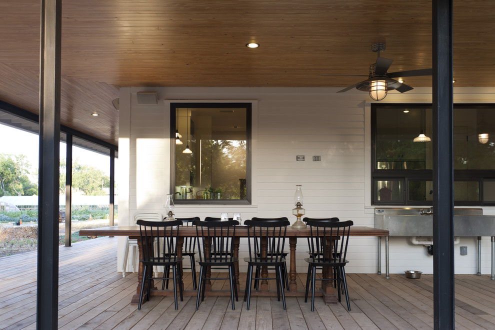 Inspiration for a farmhouse porch remodel in Austin with decking and a roof extension