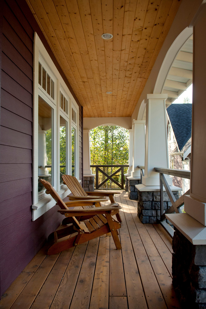 Elegant porch photo in Vancouver with decking