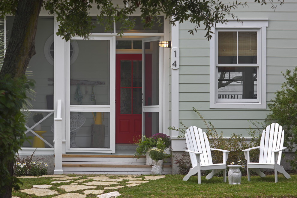 Mid-sized beach style screened-in front porch idea in Atlanta with a roof extension