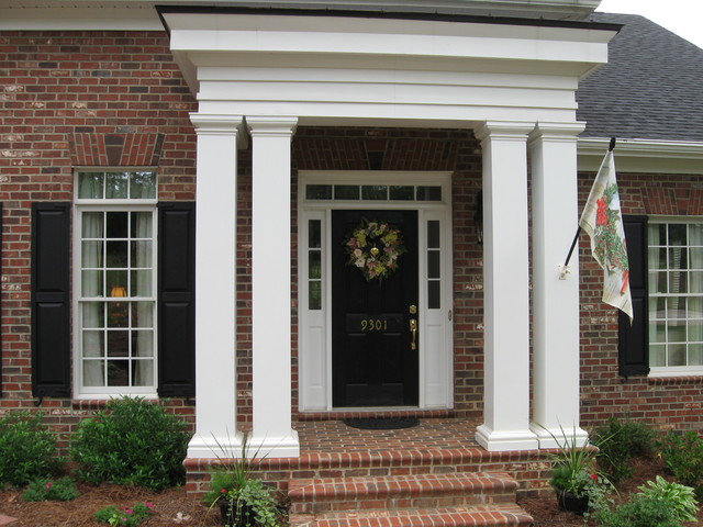 Front entry with columns for House plans with columns and porches