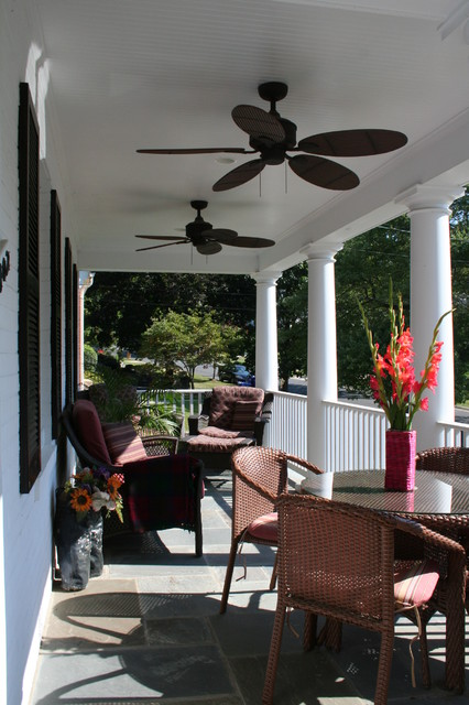 Front Porch With Ceiling Fans And Wicker Furniture