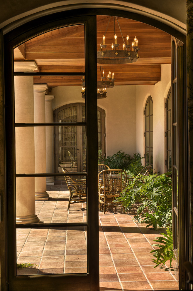 Tuscan porch photo in Other with a roof extension