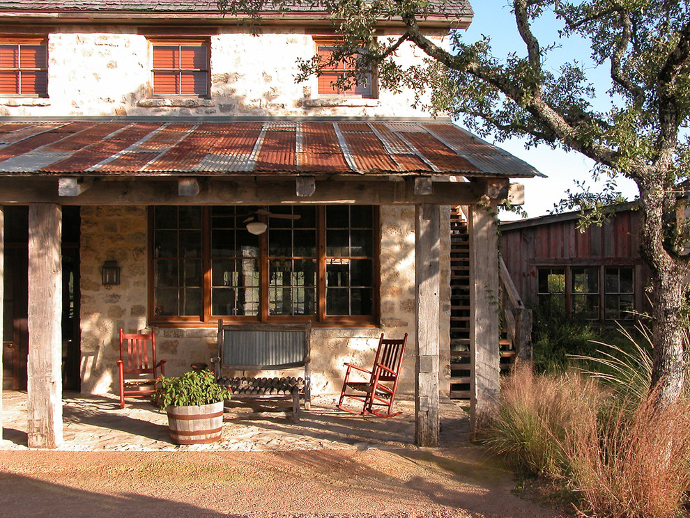 This is an example of a rustic porch design in Austin.