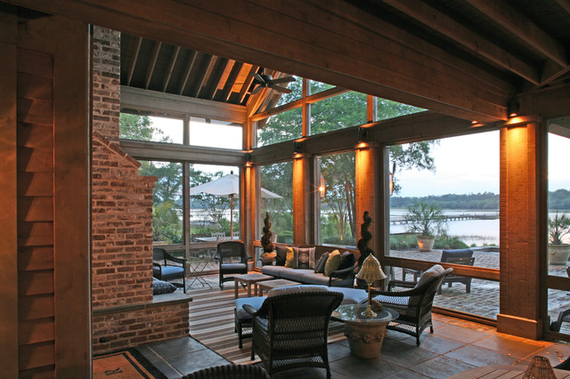 Glass uppers protect outdoor fireplace on screened porch for Screened in porch fireplace ideas