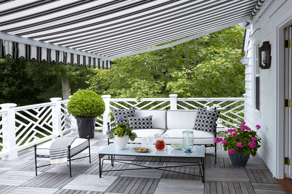 This is an example of a traditional porch design in New York with decking and an awning.