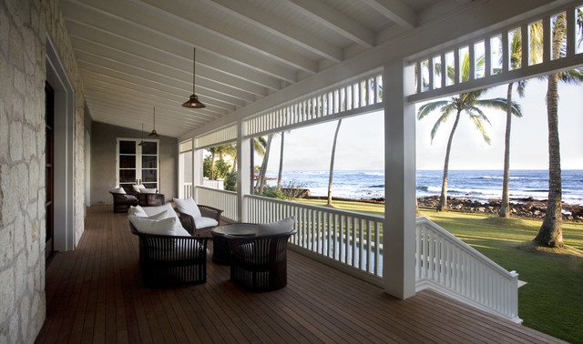 This is an example of a tropical porch design in San Francisco with decking and a roof extension.