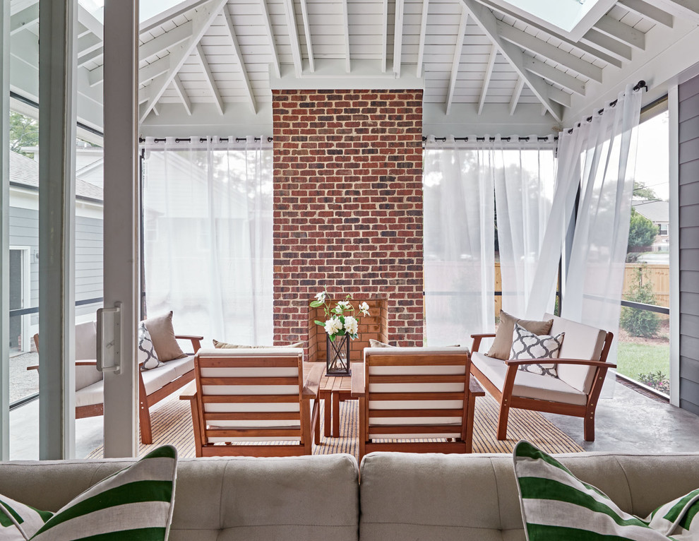 Inspiration for a timeless screened-in back porch remodel in Charlotte