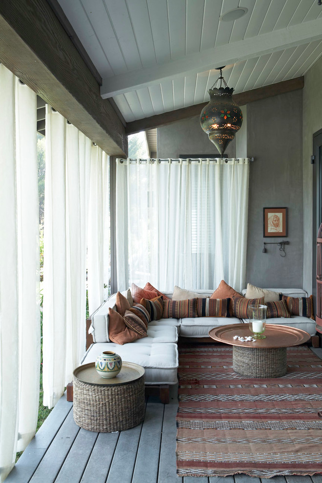 Tuscan porch idea in Los Angeles with decking and a roof extension